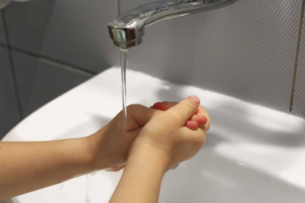 Child wash hands to prevent flu
